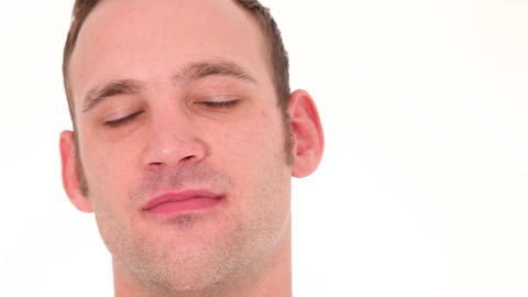 Young man listening carefully Stock Video Footage