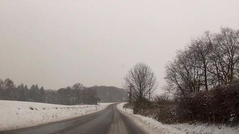 Drive Through Snowfall In The Mountains stock footage
