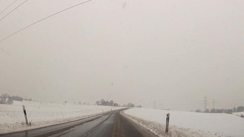 Drive through snowfall in the mountains Stock Video Footage