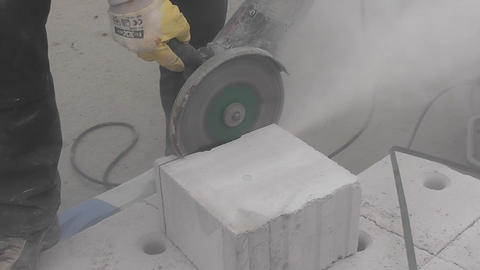 Workman trimming a stone block Stock Video Footage