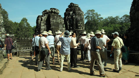Tourists are visiting Bayon Temple in Angkor, Siem Reap... Stock Video Footage