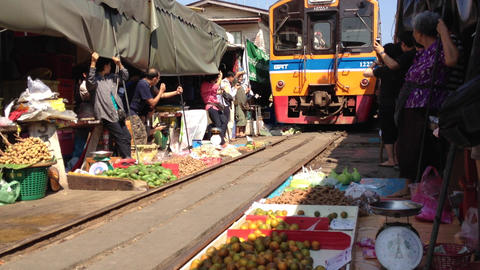Train going through a Thai Market Footage