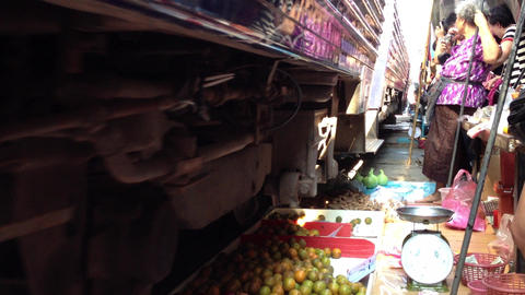Train going through a Thai Market Stock Video Footage