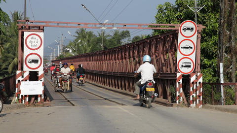 Traffic on old bridge over the Mekong river, Luang... Stock Video Footage