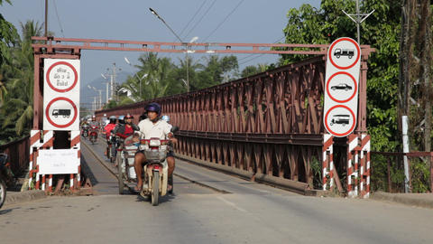 Traffic on old bridge over the Mekong river, Luang Prabang, Laos Footage
