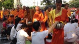 Mass Alms Giving in Bangkok Stock Video Footage