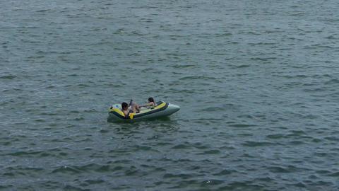 People play toy boat on sea.Toys kayaking kayak... Stock Video Footage