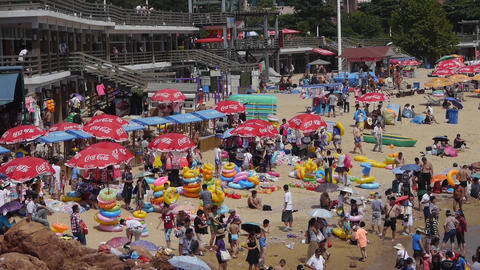 A lot of people at crowded bathing beach.China's Qingdao City.swim ring.timelaps Footage