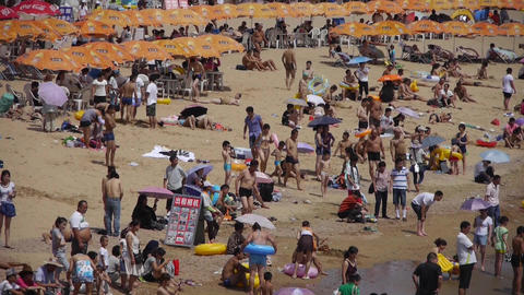 A lot of people at crowded bathing sandy beach.People... Stock Video Footage