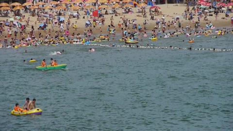 A lot of people at crowded bathing sandy beach.Boat &... Stock Video Footage