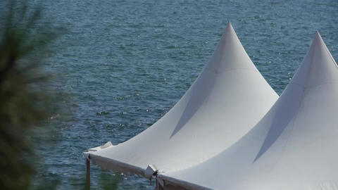Water ripples surface & white pavilion shed Stock Video Footage