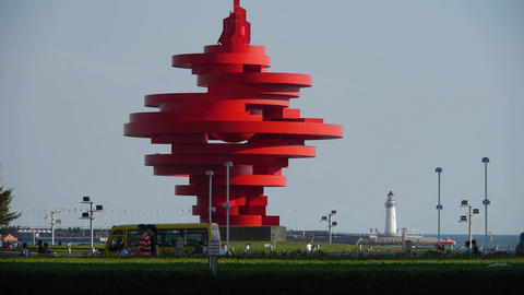 Red torch sculpture & Seaside lighthouse.This public sculpture called May th Footage