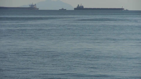 Water ripples surface.Tanker ship on sea.skyline Stock Video Footage
