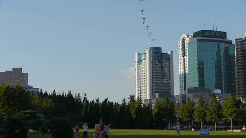 city life,People play kite on square,relying on high-rise buildings Footage