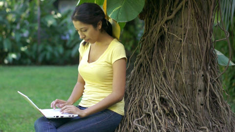 Woman using a laptop Stock Video Footage