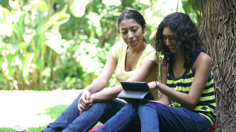 Young women looking at a tablet computer Stock Video Footage