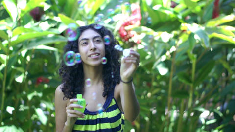 Teenager Blowing Soap Bubbles Stock Video Footage