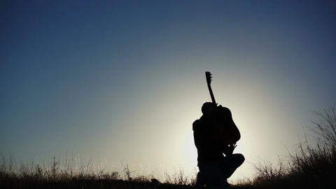 Silhouette Guitar in Air One Hand Stock Video Footage