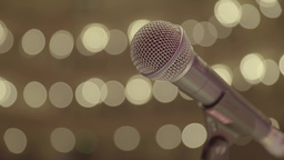 A microphone on a stage in the light of lights. Close-up. Panorama Footage