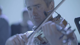 Man violinist playing violin music Footage