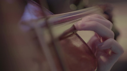Female hands on the strings of the violin while playing Footage