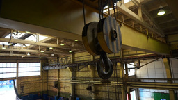 Overhead crane during work at heavy industry hall building Footage