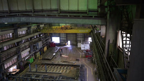 Workers work in the shipbuilding hall. Heavy Industry Footage