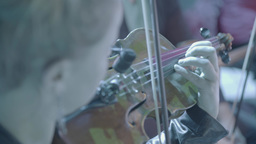 Violinist plays violin in the orchestra during the show Footage