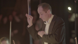 The conductor conducts an orchestra Footage