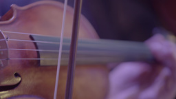The bow plays the strings of the violin (close up) Footage