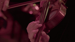 Girl violinist playing the violin on stage during a concert Footage