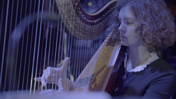 A girl harpist plays the harp Footage