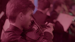 The violinist plays the violin in the orchestra Footage