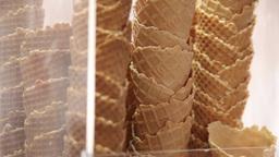 ice cream cones on stand in parlour, slider shot Footage