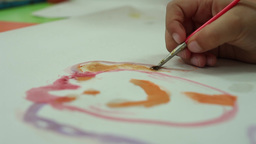 kid drawing with brush watercolor paint Live Action