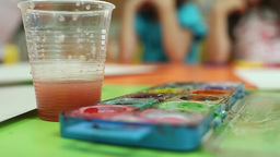 kid putting brush watercolor paint Footage
