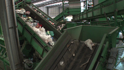 trash to recycle in a conveyor belt in recycling center Footage