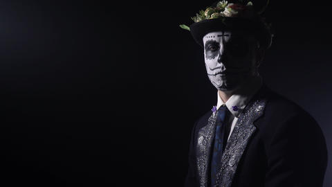 Dramatic lighting, a man at the Santa Muerte celebration with the face paint, 4k Live Action