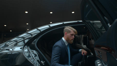 Businessman comes out of a executive car, top manager comes to the important Footage