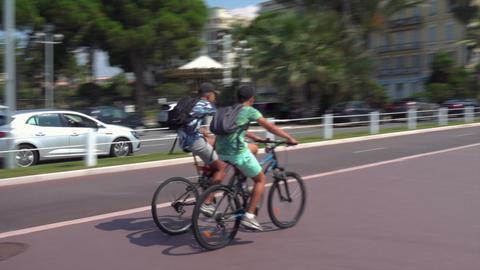 People on bicycles on Nice Promenade Live Action