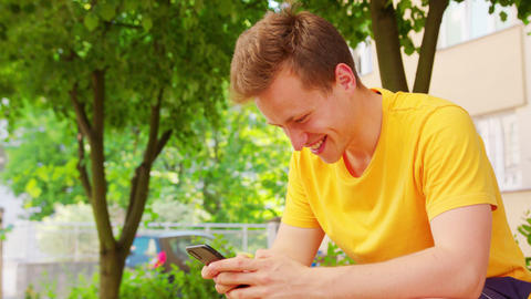 Man Using a Phone Outdoors Live Action