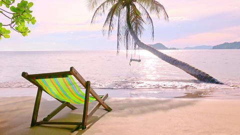 Colorful lounger on a beach and wooden swing on a palm tree. Summer paradise Footage