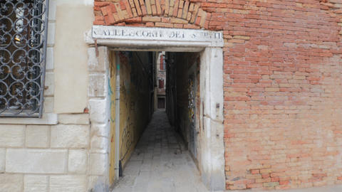 Old narrow alley in empty street of the Old Town with brick walls and graffiti Footage