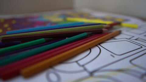Color pencils close up are on the children's coloring, slow motion Live Action