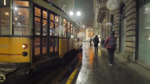 Old historical tram is moving along street in Milan in the cold winter evening Footage