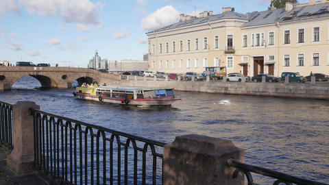 Beautiful view of Fontanka river embankment with floating small ferry boat on it Footage