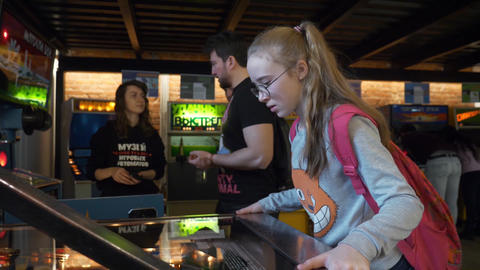 Teen girl plays old-fashioned classic table pinball in Museum of slot-machines Footage