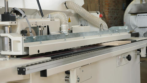 Single sided automatic edge bander on factory Footage