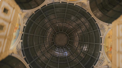Rotating camera shows dark grey round shaped ceiling in some building Footage