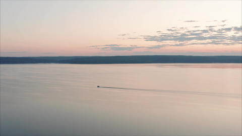 Motor boat at dawn view from a height. Morning landscape. View from the height Footage